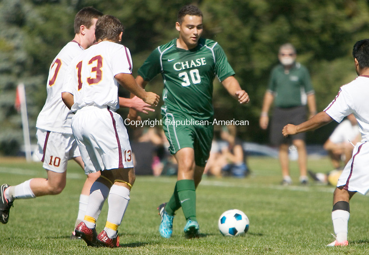 WATERBURY CT. 27 September 2014-092714SV17-#30 Jose Guardiano of Chase Collegiate weaves his way through three Marianapolis Prep players during soccer action in Waterbury Saturday.<br /> Steven Valenti Republican-American