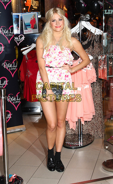 PIXIE LOTT.Pixie Lott launches her new Spring/Summer range of clothing at Lipsy, Westfield Shopping Centre, London, England..May 24th 2011.full length white pink floral strapless dress black clutch bag boots hand on hip.CAP/ROS.©Steve Ross/Capital Pictures