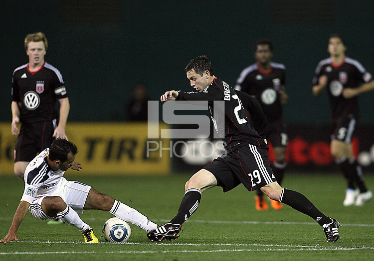 Blake Brettechneider (29) of D.C. United pokes the ball away from Juninho (19) of the Los Angeles Galaxy during an MLS match at RFK Stadium, on April 9 2011, in Washington D.C.The game ended in a 1-1 tie.