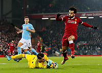 Manchester City's Ederson beats Liverpool's Mohamed Salah to a ball<br /> <br /> Photographer Alex Dodd/CameraSport<br /> <br /> The Premier League - Liverpool v Manchester City - Sunday 14th January 2018 - Anfield - Liverpool<br /> <br /> World Copyright &copy; 2018 CameraSport. All rights reserved. 43 Linden Ave. Countesthorpe. Leicester. England. LE8 5PG - Tel: +44 (0) 116 277 4147 - admin@camerasport.com - www.camerasport.com