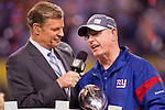 NBC's Dan Patrick interviews New York Giants Head Coach Tom Coughlin, with the Vince Lombardi Trophy, after beating the New England Patriots during the NFL Super Bowl XLVI football game on Sunday, Feb. 5, 2012, in Indianapolis. The Giants won 21-17 (AP Photo/David Stluka)...