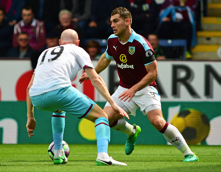 Burnley's Sam Vokes vies for possession with West Ham United's James Collins<br /> <br /> Photographer Andrew Vaughan/CameraSport<br /> <br /> The Premier League - Burnley v West Ham United - Sunday 21st May 2017 - Turf Moor - Burnley<br /> <br /> World Copyright &copy; 2017 CameraSport. All rights reserved. 43 Linden Ave. Countesthorpe. Leicester. England. LE8 5PG - Tel: +44 (0) 116 277 4147 - admin@camerasport.com - www.camerasport.com