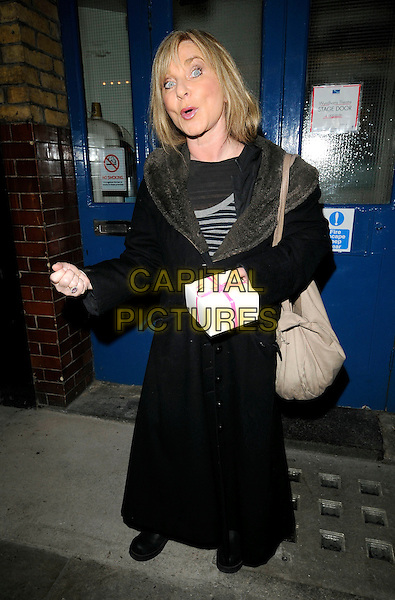 "HELEN LEDERER .Leaving after the evening performance of ""Calendar Girls"", Noel Coward Theatre, London, England, .January 5th 2009..full length black long maxi coat fur collar mouth open funny cake pastry box bag beige pink ribbon hand holding .CAP/CAN.©Can Nguyen/Capital Pictures."