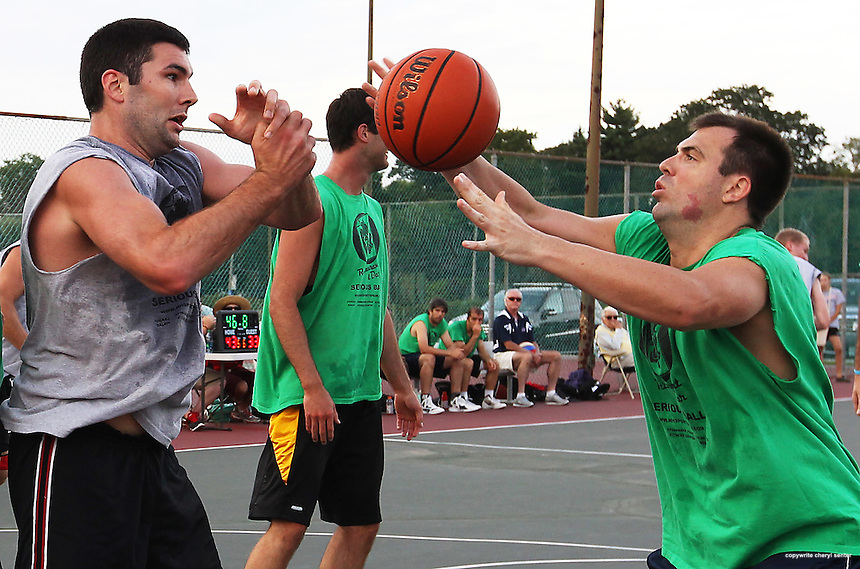 Leighton Builders  Giles Westie, left, battles under the net with CSM Sports Chris Coates during the men's basketball championship in the Serious Summer League at the South Playground in Portsmouth, N.H, Sunday, Aug. 19, 2012.Gray team wins 82 to 80.  (Portsmouth Herald Photo Cheryl Senter)