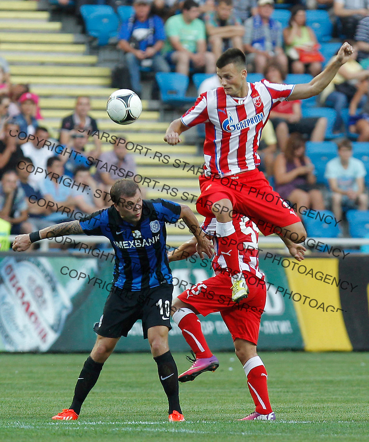 Fudbal UEFA Europa League season 2013-2014<br /> Cernomorec Vs. Crvena Zvezda<br /> Jovan Krneta right and Olexiy Gai<br /> Odessa, 02.08.2013.<br /> foto: Srdjan Stevanovic/Starsportphoto &copy;