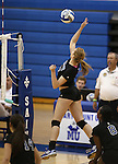 Marymount's Becca Schroeder hits in a college volleyball game, in Arlington, Vir., on Saturday, Nov. 1, 2014.<br /> Photo by Cathleen Allison