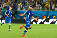 Claudio Marchisio of Italy celebrates scoring a goal after making it 0-1