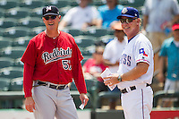 Memphis Redbirds manager Pop Warner #57 and Round Rock Express manager Steve Buechele #22 meet before the Pacific Coast League baseball game on April 27, 2014 at the Dell Diamond in Round Rock, Texas. The Express defeated the Redbirds 6-2. (Andrew Woolley/Four Seam Images)