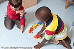 Education preschool 3 year olds health boy sneezing into the bend of his elbow other boy observing horizontal