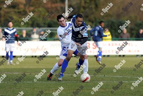 2012-02-26 / Voetbal / seizoen 2011-2012 / KSK Heist - Eupen / Jorn Rijmenams (Heist) zet Le Postollec onder druk..Foto: Mpics.be