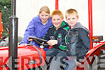 Emma, Aaron and Adam Houlihan Killorglin check out the tractors at the Castlemaine Vintage show on Sunday..