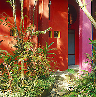 The brightly painted exterior of Edward James' house in the centre of his pleasure garden