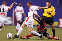 The MetroStars' Fabian Taylor shoves the Chicago Fire's Evan Whitfield a shove as he looses his balance going for a tackle. The Chicago Fire played the NY/NJ MetroStars to a one all tie at Giant's Stadium, East Rutherford, NJ, on May 15, 2004.