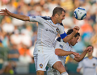 LA Galaxy defender Gregg Berhalter (16) battles with themmate defender Todd Dunivant (2) to clear a ball out of the box. The LA  Galaxy defeated the Houston Dynamo 4-1 at Home Depot Center stadium in Carson, California on Saturday evening June 5, 2010..