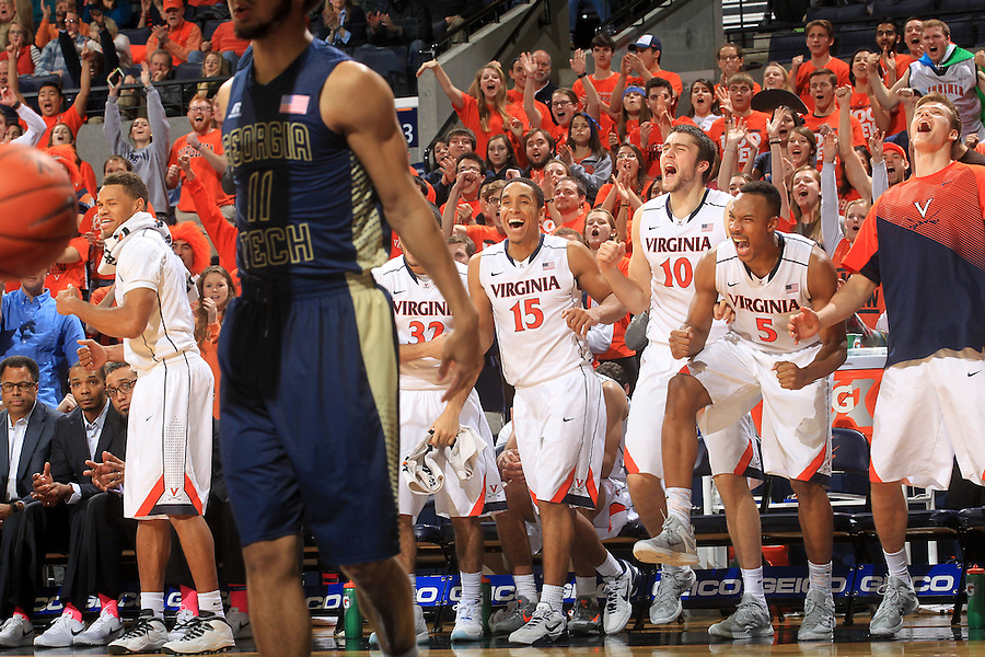 Virginia players react to a basket made in front of Georgia Tech guard Josh Heath (11) during an NCAA basketball game Thursday Jan. 22, 2015, in Charlottesville, Va. Virginia defeated Georgia Tech 57-28. (Photo/Andrew Shurtleff)