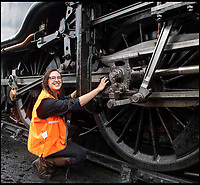 BNPS.co.uk (01202)558833<br /> Pic: PhilYeomans/BNPS<br /> <br /> New blood - Beth Attfield-Haines(29) is still training on the Swanage Railway.<br /> <br /> Growth Industry - Britain's enduring love affair with steam trains has led to a critical shortage of drivers, 56 years after the infamous Beeching Axe was supposed to have fallen.<br /> <br /> More steam train's are running today than at anytime since Dr Beechings drastic cut in 1963 - with over 150 steam heritage railways and museums attracting 13 million visitors a year.<br /> <br /> One of the most popular heritage railways in the country has put out an SOS for steam drivers - as so many of its stalwarts are retiring.<br /> <br /> Swanage Railway in Dorset has 42 steam drivers on their books, but the majority are in their 60s or older and likely to step down in the coming years.<br /> <br /> They need to train up to 40 drivers over the next five years to replace them and meet their expanding service, which attracts over 200,000 visitors each year.<br /> <br /> To fill the void, a group of enthuisastic young volunteers are being taught the skill, a process which can take up to a decade.<br /> <br /> The Heritage Railway Association, which oversees them, says some of their railways have a 'more pressing need for new blood'.