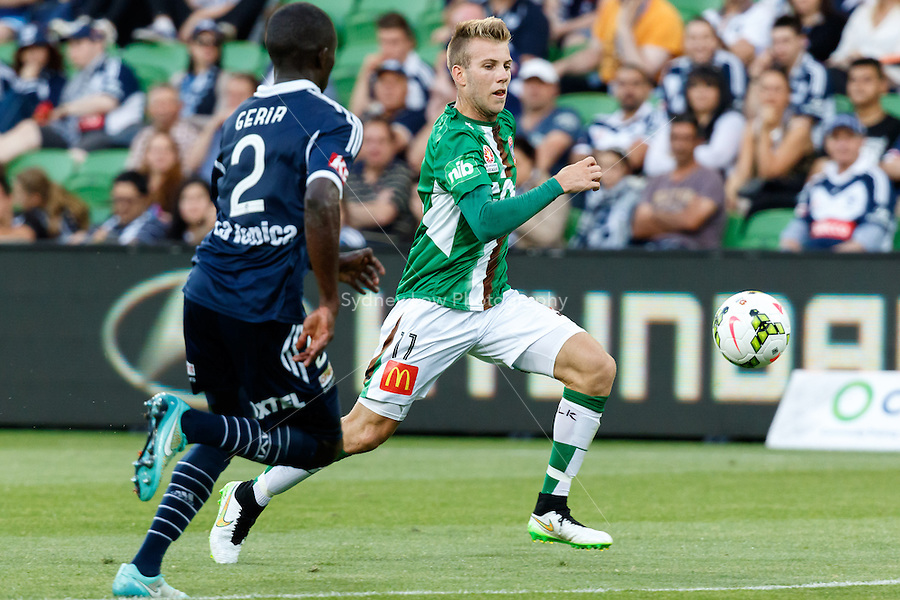 Andrew HOOLE (11) of the Jets runs with the ball in round 12 A-League match between Melbourne Victory and Newcastle Jets at AAMI Park in Melbourne, Australia during the 2014/2015 Australian A-League season. Melbourne def Newcastle 1-0