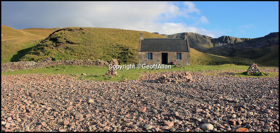 BNPS.co.uk (01202 558833)<br /> Pic: GeoffAllan/BNPS<br /> <br /> A medium sized bothy at Guirdil on the Isle of Rum.<br /> <br /> Views with rooms. - New book reveals the remote 'bothies' that lie hidden in some of Britain's most spectacular locations.<br /> <br /> Nestled away in the beautiful remote wilderness of Scotland are a network of secluded mountain huts - known as bothies - where walkers can stay the night before heading to pastures new.<br /> <br /> What is so special about these quaint outposts in some of the most idyllic and untouched landscapes north of the border is that they are completely free to use.<br /> <br /> As a result, the location of many bothies has been a closely guarded secret with visitor centres reluctant to advertise their whereabouts for fear they become overcrowded.<br /> <br /> But in his new book, The Scottish Bothy Bible, author and photographer Geoff Allan has listed more than 80 of them in a bid to make them known to a wider audience.