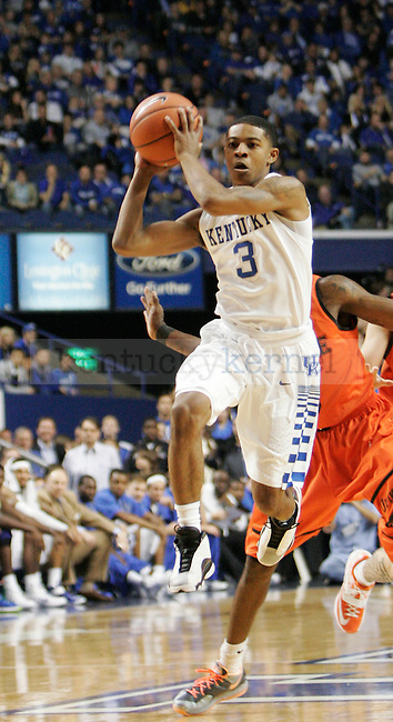 University of Kentucky freshman guard Tyler Ulis (3) looks to pass the ball during the first half of the UK men's exhibition basketball game vs. the University of Pikeville at Rupp Arena in Lexington, Ky., on Sunday, November 2, 2014. UK won 116-68. Photo by Tessa Lighty | Staff