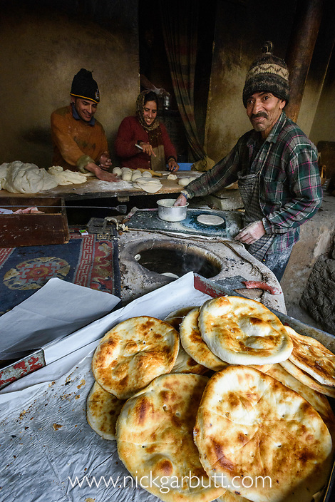 Making local naan bread in a tandoor oven. Back streets of Leh, Ladadh, India.