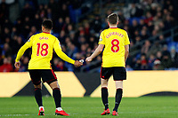 Tom Cleverley of Watford hands over the captain's armband after being sent off during the EPL - Premier League match between Crystal Palace and Watford at Selhurst Park, London, England on 12 December 2017. Photo by Carlton Myrie / PRiME Media Images.
