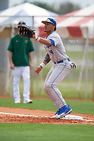 Central Connecticut State Blue Devils first baseman TT Bowens (24) stretches for a throw during a game against the North Dakota State Bison on February 23, 2018 at North Charlotte Regional Park in Port Charlotte, Florida.  North Dakota State defeated Connecticut State 2-0.  (Mike Janes/Four Seam Images)