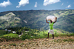 A woman walks home from the market in Les Palmes, a rural village in southern Haiti where the Lutheran World Federation has been working with survivors of the 2010 earthquake, along with other residents, to experience more abundant life.