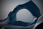 Iceberg archway in an iceberg calved from the 110km wide Humboldt Glacier, Kane Basin, remote north west Greenland