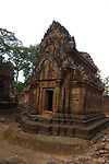 Angkorian temple Banteay Srei (late 10th century) 967.<br /> West doorway into the southern library.Pediment shows Shiva with Uma while Kama fires an arrow of love.<br /> Three sanctuary towers.The central sanctuary and the southern sanctuary were dedicated to Shiva and the northern sanctuary was dedicated to Vishnu.<br /> Banteay Srei temple is situated 20km north of Angkor, built during the reign of Rajendravarman by Yajnavaraha, one of his counsellors. In antiquity Isvarapura was a small city that grew up around the temple. Banteay Srei was dedicated to the worship of Shiva, the foundation stele describes the consecration of the linga Tribhuvanamahesvara (Lord of the three worlds) in 967.