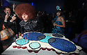 ** EXCLUSIVE **Perez Hilton blows out the candles while Selena Gomez watches at Perez Hilton's Blue Ball birthday celebration Saturday March 26, 2011, in the Hollywood section of Los Angeles. (Donald Traill/AP Images)