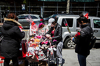 NEW YORK, NY - MAY 10: Three women wearing face masks look at the flowers and items a woman sells in Jackson Heights on Mother's Day on May 10, 2020 in Queens, New York. COVID-19 has spread to most countries in the world, claiming more than 283,000 lives and more than 4.1 million people infected, Queens has been one of the places most affected by the Coronavirus. (Photo by Pablo Monsalve / VIEWpress via Getty Images)