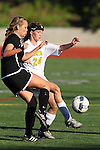 Manhattan Beach, CA 01/25/10 - Kimby Keever (Mira Costa #24) and Meredith Meyer (Palos Verdes #11) in action during the Bay League game between Mira Costa and Palos Verdes, Palos Verdes defeated Mira Costa 2-0.
