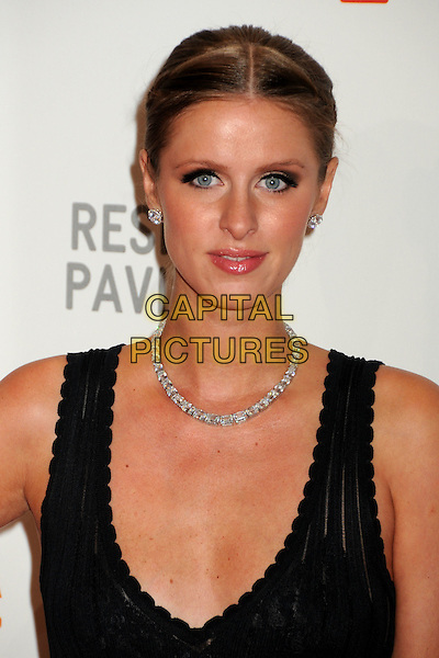 "NICKY HILTON  .at LACMA's ""The Unmasking"" The Lynda & Stewart Resnick Exhibition Pavilion Opening Gala at The Los Angeles County Museum of Art in Los Angeles, California, USA, September 25th 2010..portrait headshot black necklace hair up diamond earrings make-up beauty .CAP/ADM/BP.©Byron Purvis/AdMedia/Capital Pictures."