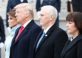 First Lady Melania Trump, United States President Donald Trump, Vice President Mike Pence and Karen Pence stand on the east front steps of the Capitol Building after Trump is sworn in at the 58th Presidential Inauguration on Capitol Hill in Washington, D.C. on January 20, 2017.  <br /> Credit: John Angelillo / Pool via CNP