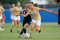 27 August 2011:  FIU's Deana Rossi (17) battles Akron's Ashley Hughes (7) while moving the ball down the field in the first half as the University of Arkon Zips faced off against the FIU Golden Panthers at University Park Stadium in Miami, Florida.