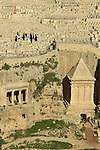 Israel, Jerusalem, Kidron valley, the tombs of Zecharia (right) and Bene Hazir (left) are carved at the foot of the Mount of Olives facing Temple Mount, above is the Jewish cemetery