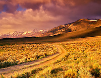 Steens Mountain with road and clouds. Oregon