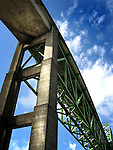 A high rail bridge against a blue sky