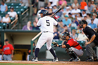 Empire State Yankees outfielder Darnell McDonald #5 at bat in front of catcher Tony Sanchez and umpire Jeff Gosney during a game against the Indianapolis Indians at Frontier Field on August 4, 2012 in Rochester, New York.  Empire State defeated Indianapolis 9-8 in ten innings.  (Mike Janes/Four Seam Images)