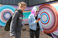 NWA Democrat-Gazette/DAVID GOTTSCHALK Dylan Mosley (left), from Southside High School in Fort Smith, visits with Kaylan Mitchum, a junior  at Rogers New Technology High School, before a video session Wednesday, October 10, 2019, during day one of the 9th Annual Ozark Media Arts Festival in downtown Springdale. High School students from more than 45 media programs in Arkansas are participating in the two day event that showcases video and photography and offers industry led workshops, onsite competitions, and a network to education and industry.