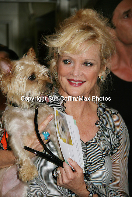 """Christine Ebersole - OLTL and in Broadway's Blithe Spirit at Broadway Barks 11 - a """"Pawpular"""" star-studded dog and cat adopt-a-thon on July 11, 2009 in Shubert Alley, New York City, NY. (Photo by Sue Coflin/Max Photos)"""
