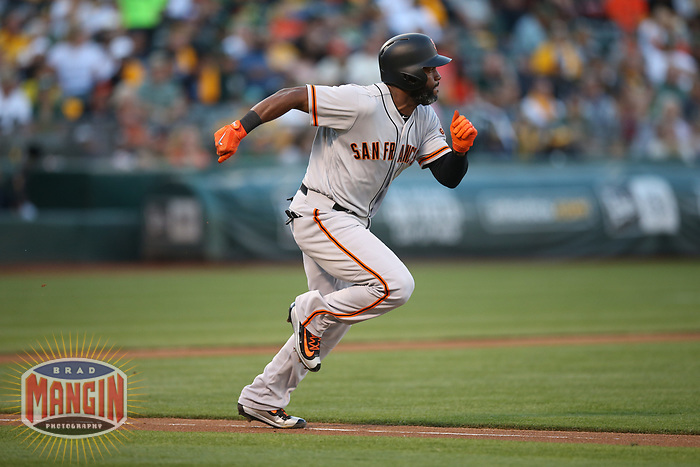 OAKLAND, CA - JULY 31:  Denard Span #2 of the San Francisco Giants runs to first base against the Oakland Athletics during the game at the Oakland Coliseum on Monday, July 31, 2017 in Oakland, California. (Photo by Brad Mangin)