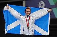 Scotland's Daniel Purvis gymnastic artistic men's rings final gold medal<br /> <br /> Photographer Chris Vaughan/CameraSport<br /> <br /> 20th Commonwealth Games - Day 8 - Thursday 31st July 2014 - Gymnastics - The SSE Hydro - Glasgow - UK<br /> <br /> © CameraSport - 43 Linden Ave. Countesthorpe. Leicester. England. LE8 5PG - Tel: +44 (0) 116 277 4147 - admin@camerasport.com - www.camerasport.com
