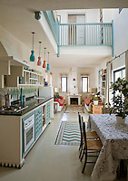 The colourful mouth blown lights in the kitchen were from Anthony Stern