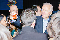 Surrounded by press and campaign staff, Democratic presidential candidate and former Vice President Joe Biden greets people and poses for selfies after speaking at a campaign event at The Sports Barn in Hampton, New Hampshire, on Sun., December 8, 2019.