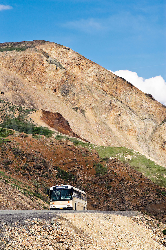 Park tour bus on the narrow winding road through Denali National Park, Alaska
