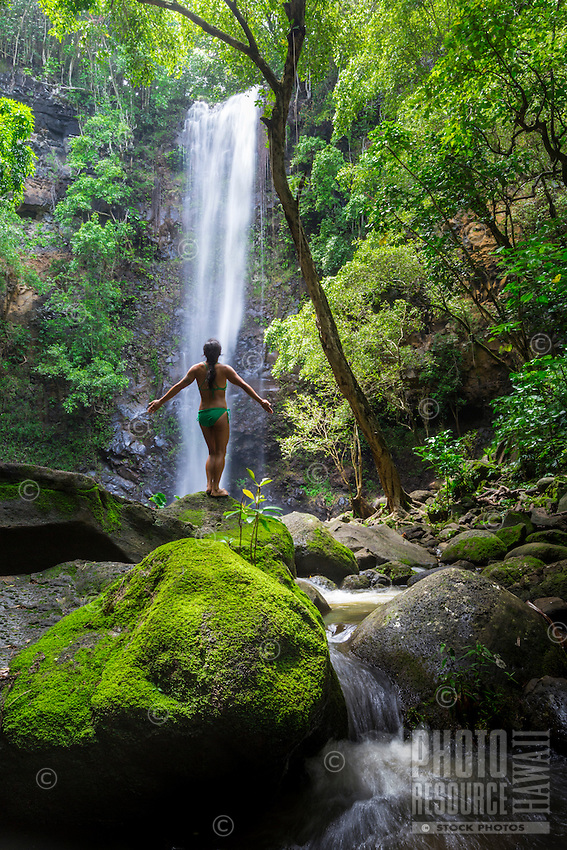 A woman enjoys the view at Uluwehi Falls, Kaua'i.