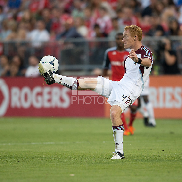 18 July 2012: Colorado Rapids midfielder Jeff Larentowicz #4 in action during an MLS game between the Colorado Rapids and Toronto FC at BMO Field in Toronto, Ontario..Toronto FC won 2-1..