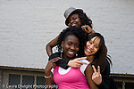 Education High School  senior students posing and having fun outside school building group of three girls posing horizontal