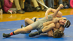 Spanish Springs Cougars Hunter Harrison, bottom, wrestles Reno Huskies Connor Pearson in the 138 pound weight class on Wednesday night, January 13, 2016 at Reno High School.